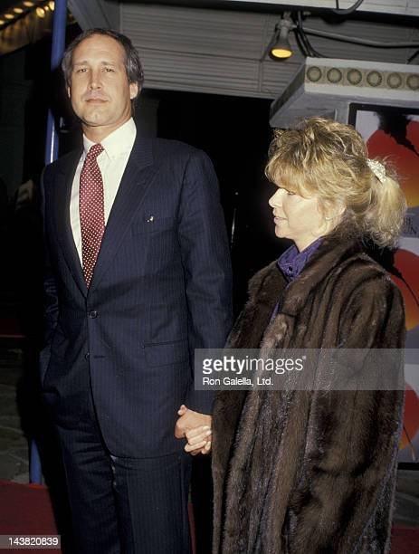 Chevy Chase and wife Jaynie Chase attend the premiere of 'Empire of the Sun' on December 8 1987 at Mann Village Theater in Westwood California