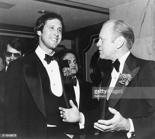 Chevy Chase of NBC's Saturday Night TV show with President Gerald Ford at a Washington Correspondent's dinner reception