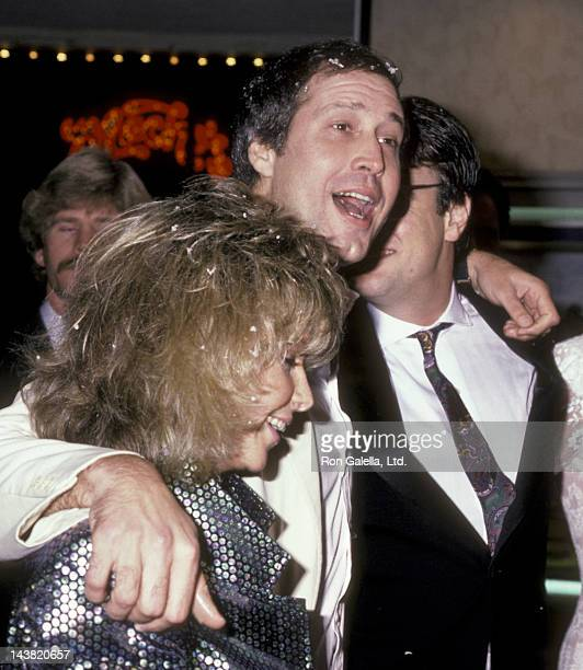 Chevy Chase wife Jaynie Chase Dan Akroyd and Donna Dixon attend the premiere of 'Spies Like Us' on December 3 1985 at Mann Bruin Theater in Westwood...