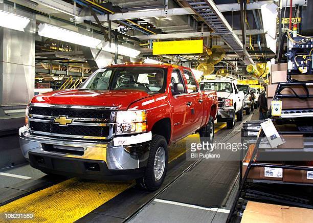 Chevy pickup truck drives off the assembly line of the General Motors Flint Assembly Plant January 24 2011 in Flint Michigan In response to customer...