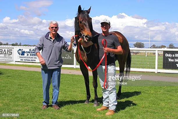 Chew Toy in the mounting yard with connections after winning Killawarra Kennels & Cattery BM58 Handicap on November 14, 2016 in Wangaratta, Australia.