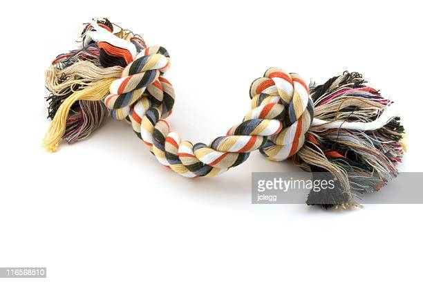 chewable dog toy rope - dogs tug of war stock pictures, royalty-free photos & images