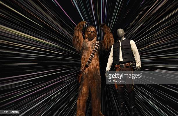 Chewbacca and Han Solos 1983 costumes are part of the Star Wars and The Power of Costume exhibit at The Denver Art Museum November 10 2016 The...