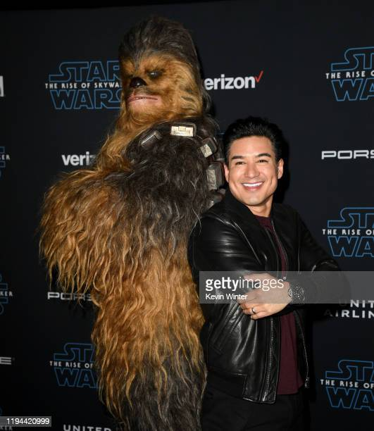 "Chewbacca and Mario Lopez arrive at the premiere of Disney's ""Star Wars: The Rise Of The Skywalker"" on December 16, 2019 in Hollywood, California."
