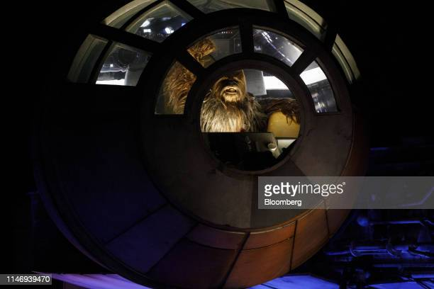 Chewbacca character actor is seen inside the Millennium Falcon during the unveiling of Star Wars: Galaxy's Edge at Walt Disney Co.'s Disneyland theme...