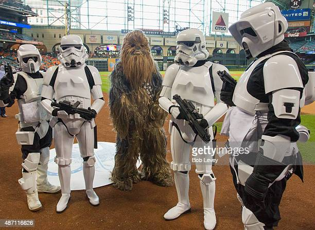 Chewbacca character along with the Stormtroopers take the field on Star Wars Day before the game between the Minnesota Twins and Houston Astros at...