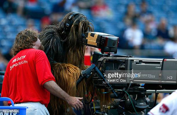 Chewbacca character from the 501st Legion stands in as a videographer prior to the game between the Atlanta Braves and the New York Mets at Turner...