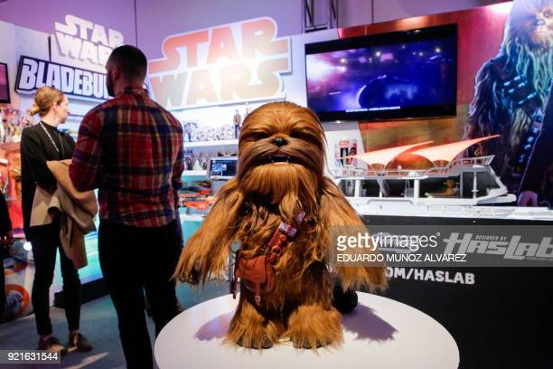 A Chewbacca doll is displayed as people visit the Star Wars booth at the Hasbro showroom during the annual New York Toy Fair on February 20 in New...