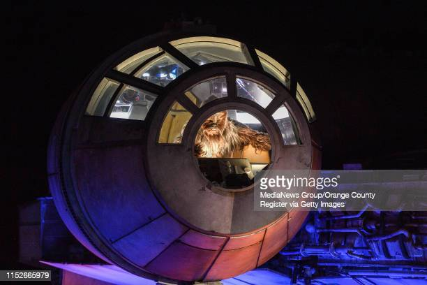 Chewbacca greets visitors from the cockpit of the Millennium Falcon during a dedication ceremony for Star Wars: Galaxy's Edge at Disneyland in...