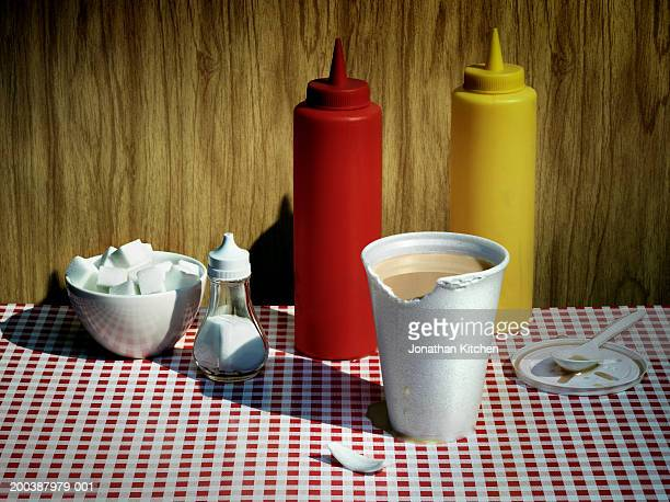 Chewed polystyrene cup by condiments