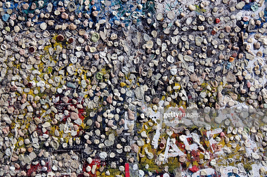 Chewing gums sticked on wall : Stock Photo
