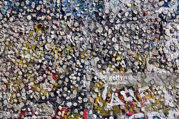 chewing gums sticked on wall - david oliete stock pictures, royalty-free photos & images