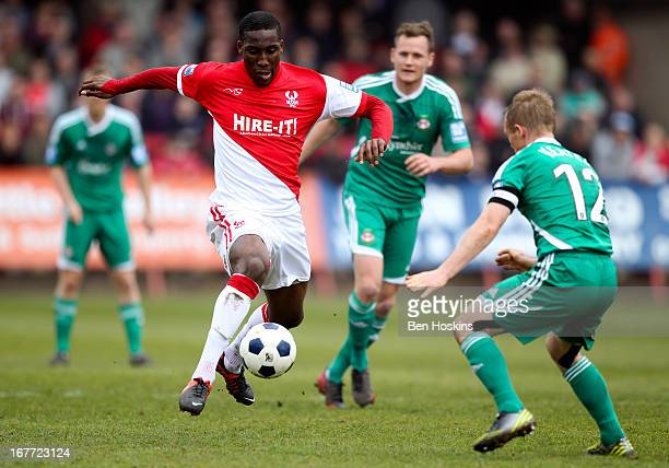 Chey Dunkley of Kidderminster controls the ball ahead of Dean Keates of Wrexham during the Blue Square Bet Premier Division Playoff semifinal second...