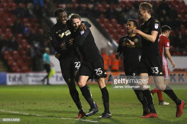 Chey Dunkley of Wigan Athletic celebrates after scoring a goal to make it 30 during the Sky Bet League One match between Wigan Athletic and Walsall...