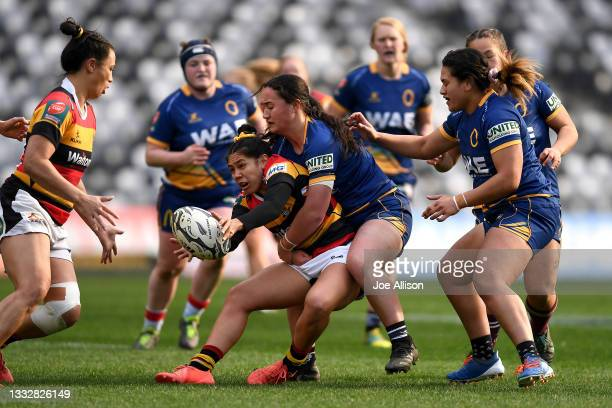 Cheyelle Robins-Reti of Waikato offloads the ball during the round four Farah Palmer Cup match between Otago and Waikato at Forsyth Barr Stadium, on...