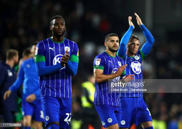 Cheyenne Dunkley Joe Garner and Sam Sayed Morsy of Wigan Athletic applaud the fans after the Sky Bet Championship match between Fulham and Wigan...