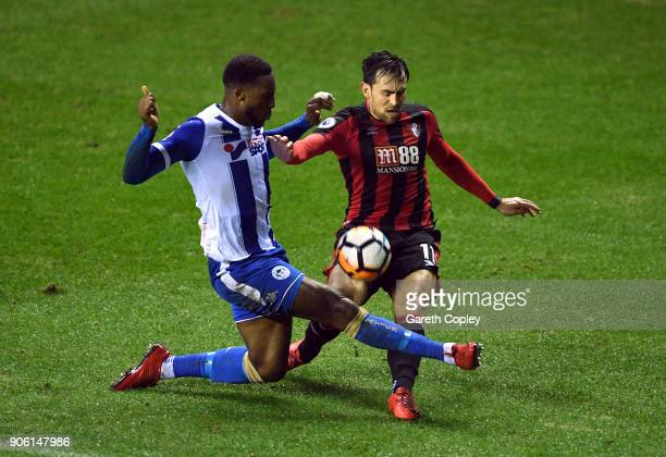 Cheyenne Dunkley of Wigan Athletic and Charlie Daniels of AFC Bournemouth in action during The Emirates FA Cup Third Round Replay between Wigan and...