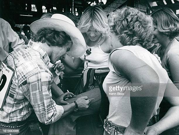 JUL 24 1977 JUL 25 1977 JUL 26 1977 Cheyenne Frontier Days Don Gay Placates groupies by signing his autograph on girls pant leg