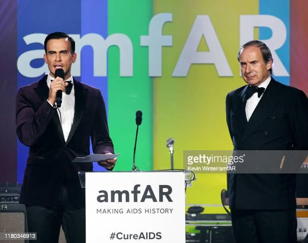 Cheyenne Jackson and Simon de Pury speak onstage during the 2019 amfAR Gala Los Angeles at Milk Studios on October 10, 2019 in Los Angeles,...