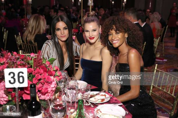 Cheyenne Maya Carty and Sofia Resing pose with guest at the 2018 Angel Ball hosted by Gabrielle's Angel Foundation at Cipriani Wall Street on October...