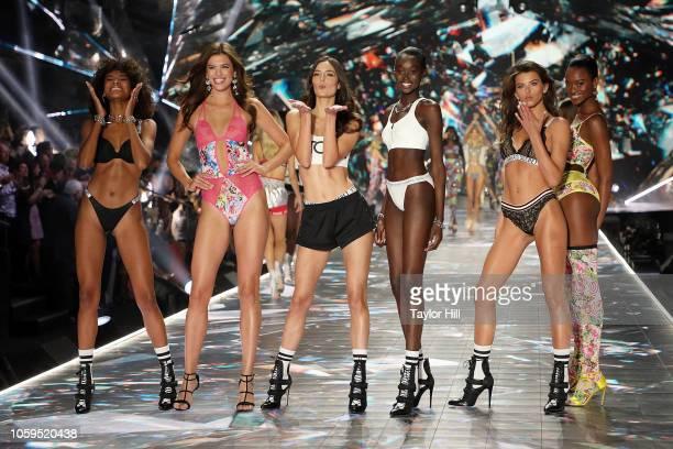 Cheyenne Maya Carty Sofie Rovenstine Sadie Newman Subah Koj Georgia Fowler and Mayowa Nicholas walk the runway during the 2018 Victoria's Secret...