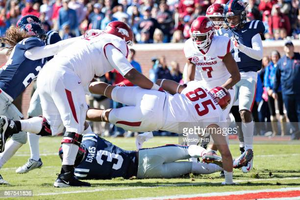 Cheyenne O'Grady of the Arkansas Razorbacks dives across the goal line for a touchdown during a game against the Ole Miss Rebels at Hemingway Stadium...