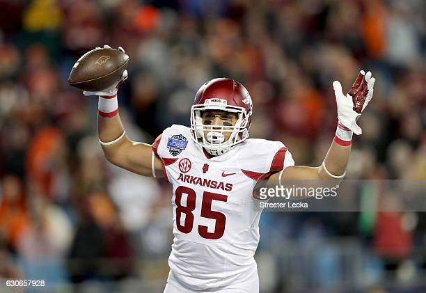 Cheyenne O'Grady of the Arkansas Razorbacks reacts after catching a touchdown pass against the Virginia Tech Hokies during the Belk Bowl at Bank of...