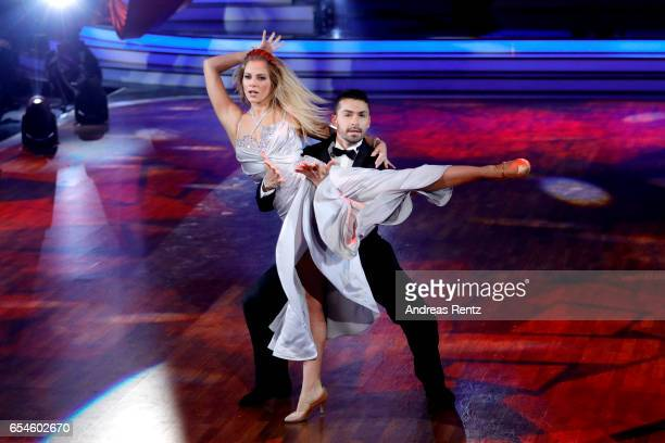 Cheyenne Pahde and Andrzej Cibis perform on stage during the 1st show of the tenth season of the television competition 'Let's Dance' on March 17,...