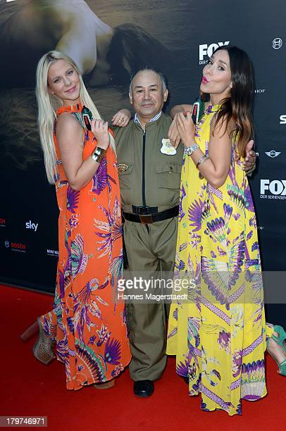Cheyenne Pahde and Sandra Ahrabian pose with an actor portraying a police officer at the 'The Bridge America' preview screening of channel FOX on...