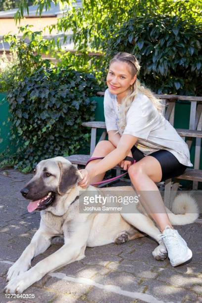 Cheyenne Pahde poses with dog Bella during a photocall at animal shelter Dellbrueck on September 15, 2020 in Cologne, Germany.