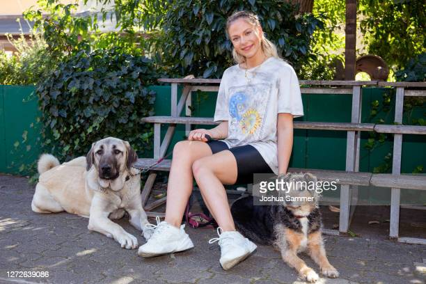 Cheyenne Pahde poses with the dogs Bella and Lupo during a photocall at animal shelter Dellbrueck on September 15, 2020 in Cologne, Germany.
