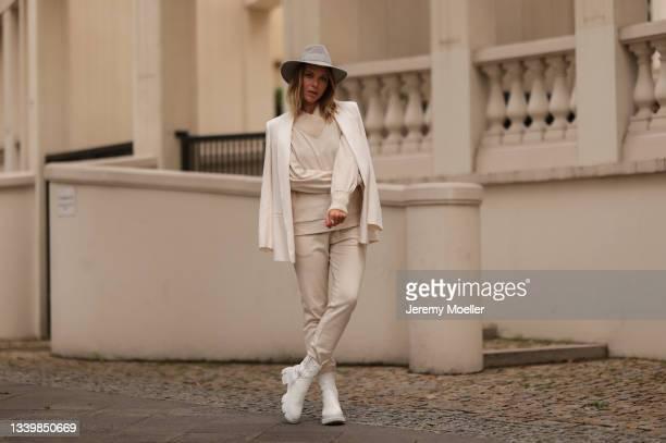 Cheyenne Pahde wearing Riani beige pants, knit beige Riani sweater and beige blazer, beige hat and Copenhagen Studios beige boots on September 11,...