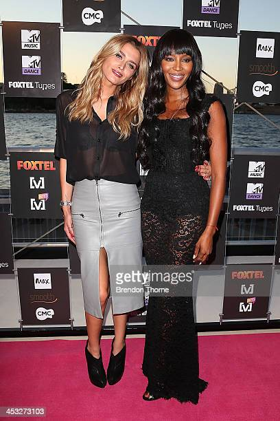 Cheyenne Tozzi and Naomi Campbell arrives at the Foxtel Music Channels Summer Launch at the Botanic Gardens on December 3 2013 in Sydney Australia