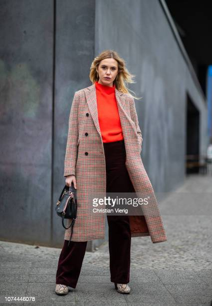 Cheyenne Tulsa is seen wearing bordeaux velvet pants and jumper Lacoste boots with snake print Find plaid coat 2ndday Coach bag on December 19 2018...