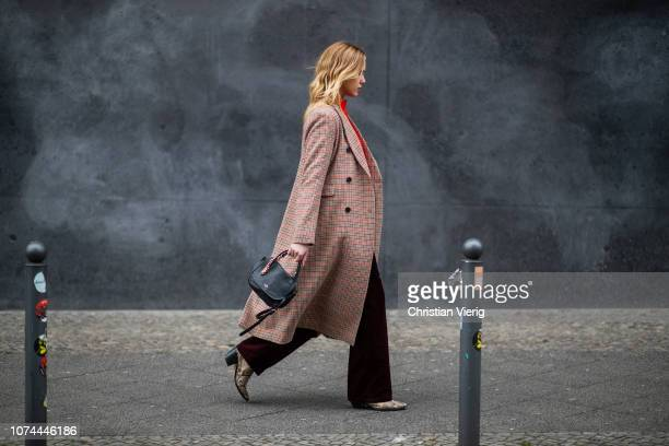 Cheyenne Tulsa is seen wearing bordeaux velvet pants and jumper Lacoste, boots with snake print Find, plaid coat 2ndday, Coach bag on December 19,...