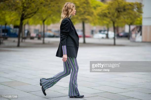 Cheyenne Tulsa is seen wearing striped top and pants Stieglitz black blazer Margiela cowboy boots vintage on April 05 2019 in Berlin Germany