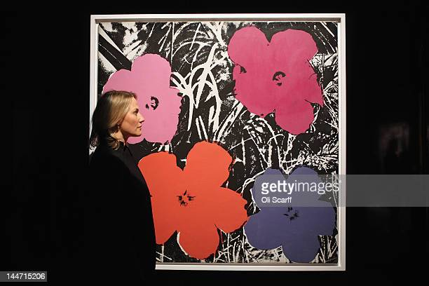 Cheyenne Westphal Sotheby's Chairman of Contemporary Art in Europe views an artwork by Andy Warhol entitled 'Flowers' which is expected to fetch 4...