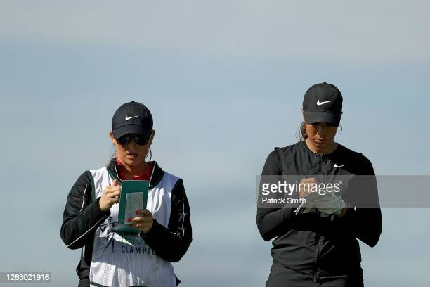 Cheyenne Woods and her caddie prepare for a shot from the 15th tee during the first round of the LPGA Drive On Championship at Inverness Club on July...