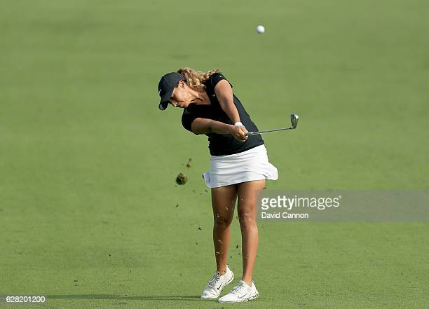 Cheyenne Woods of the United States plays her second shot on the 14th hole during the first round of the 2016 Omega Dubai Ladies Masters on the...