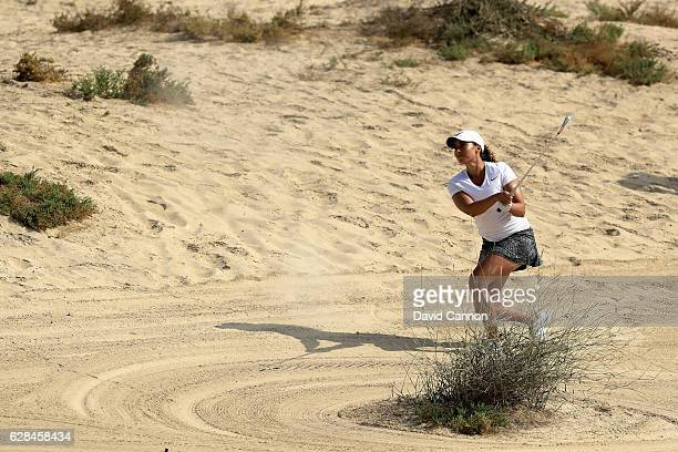 Cheyenne Woods of the United States plays her second shot on the eighth hole during the completion of the first round of the 2016 Omega Dubai Ladies...