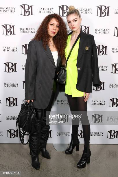 Cheyma Ha and Malie Tremblay pose backstage for Badgley Mischka during New York Fashion Week: The Shows at Gallery I at Spring Studios on February...