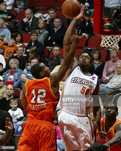 Cheyne Gadson of the Albuquerque Thunderbirds gets a shot blocked by Marvin Phillips of the Iowa Energy on December 04 2008 at Wells Fargo Arena in...