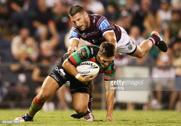 Cheyne Whitelaw of the Rabbitohs is tackled by Lewis Brown of the Sea Eagles during the NRL trial match between the Manly Sea Eagles and the South...