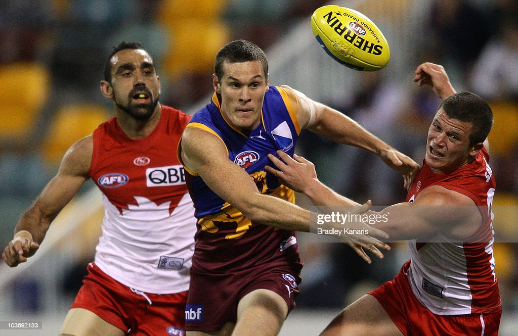Cheynee Stiller of the Lions and Jarred Moore of the Swans compete for the ball during the round 22 AFL match between the Brisbane Lions and the Sydney Swans at The Gabba on August 28, 2010 in Brisbane, Australia.