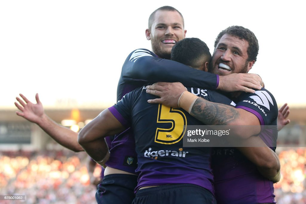 Cheyse Blair, Josh Addo-Carr and Kenny Bromwich of the Storm celebrate Josh Addo-Carr scoring a try during the round nine NRL match between the St George Illawarra Dragons and the Melbourne Storm at WIN Stadium on April 30, 2017 in Wollongong, Australia.