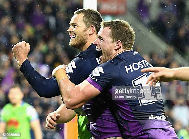 Cheyse Blair of the Storm celebrates scoring a try during the NRL Preliminary Final match between the Melbourne Storm and the Canberra Raiders at...
