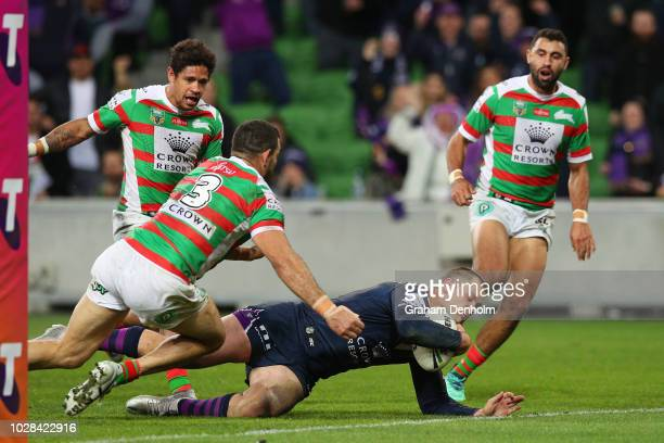 Cheyse Blair of the Storm dives in to score a try during the NRL Qualifying Final match between the Melbourne Storm and the South Sydney Rabbitohs at...