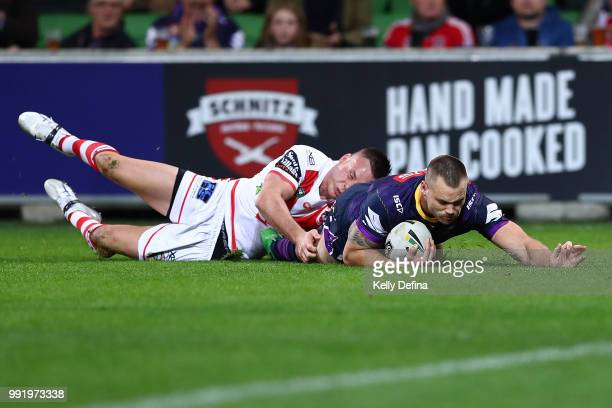 Cheyse Blair of the Storm scores a try during the round 17 NRL match between the Melbourne Storm and the St George Illawarra Dragons at AAMI Park on...