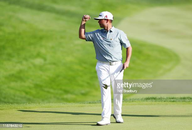 Chez Reavie of the United States celebrates on the 18th green after making a par to win the Travelers Championship at TPC River Highlands on June 23...