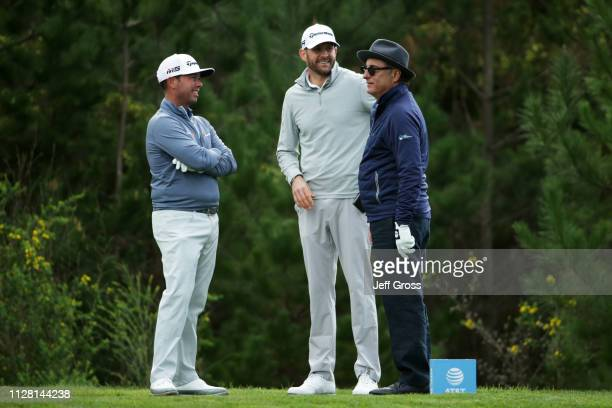 Chez Reavie of the United States DJ Trahan of the United States and Andy Garcia talk during the first round of the ATT Pebble Beach ProAm at Monterey...